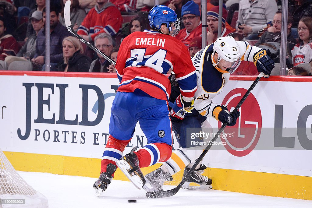 <a gi-track='captionPersonalityLinkClicked' href=/galleries/search?phrase=Alexei+Emelin&family=editorial&specificpeople=723573 ng-click='$event.stopPropagation()'>Alexei Emelin</a> #74 of the Montreal Canadiens body checks <a gi-track='captionPersonalityLinkClicked' href=/galleries/search?phrase=Jason+Pominville&family=editorial&specificpeople=570525 ng-click='$event.stopPropagation()'>Jason Pominville</a> #29 of the Buffalo Sabres during the NHL game at the Bell Centre on February 2, 2013 in Montreal, Quebec, Canada. The Canadiens defeated the Sabres 6-1.