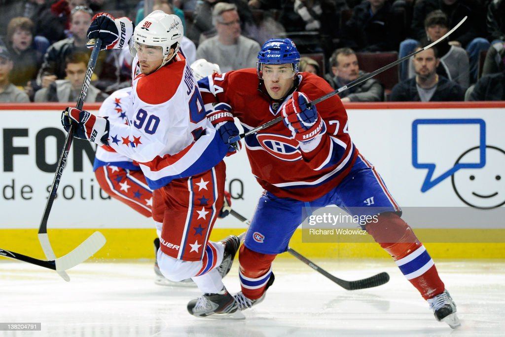 Alexei Emelin of the Montreal Canadiens body checks Marcus Johansson of the Washington Capitals during the NHL game at the Bell Centre on February 4...