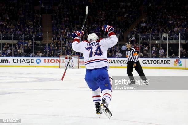 Alexei Emelin of the Montreal Canadiens celebrates after scoring a goal against Henrik Lundqvist of the New York Rangers during the first period in...