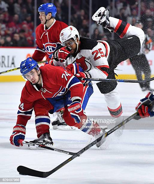 Alexei Emelin of the Montreal Canadiens checks Devante SmithPelly of the New Jersey Devils in the NHL game at the Bell Centre on December 8 2016 in...