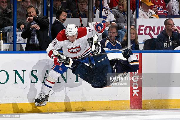 Alexei Emelin of the Montreal Canadiens checks Paul Stastny of the St Louis Blues at the Scottrade Center on January 16 2016 in St Louis Missouri