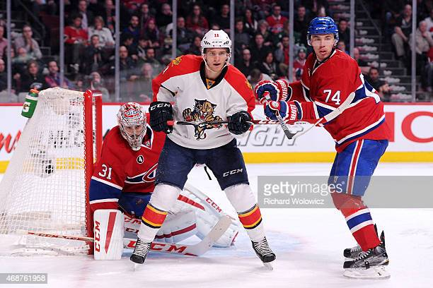 Alexei Emelin of the Montreal Canadiens defends against Jonathan Huberdeau of the Florida Panthers during the NHL game at the Bell Centre on March 28...