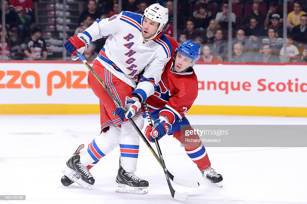 <a gi-track='captionPersonalityLinkClicked' href=/galleries/search?phrase=Alexei+Emelin&family=editorial&specificpeople=723573 ng-click='$event.stopPropagation()'>Alexei Emelin</a> #74 of the Montreal Canadiens defends against <a gi-track='captionPersonalityLinkClicked' href=/galleries/search?phrase=Taylor+Pyatt&family=editorial&specificpeople=204508 ng-click='$event.stopPropagation()'>Taylor Pyatt</a> #14 of the New York Rangers during the NHL game at the Bell Centre on February 23, 2013 in Montreal, Quebec, Canada. The Canadiens defeated the Rangers 3-0.
