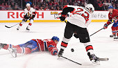 Alexei Emelin of the Montreal Canadiens defends the goal against Erik Condra of the Ottawa Senators in the NHL game at the Bell Centre on December 20...