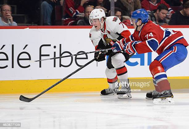 Alexei Emelin of the Montreal Canadiens fights for the puck against Kyle Turris the Ottawa Senators during the NHL game on January 4 2014 at the Bell...