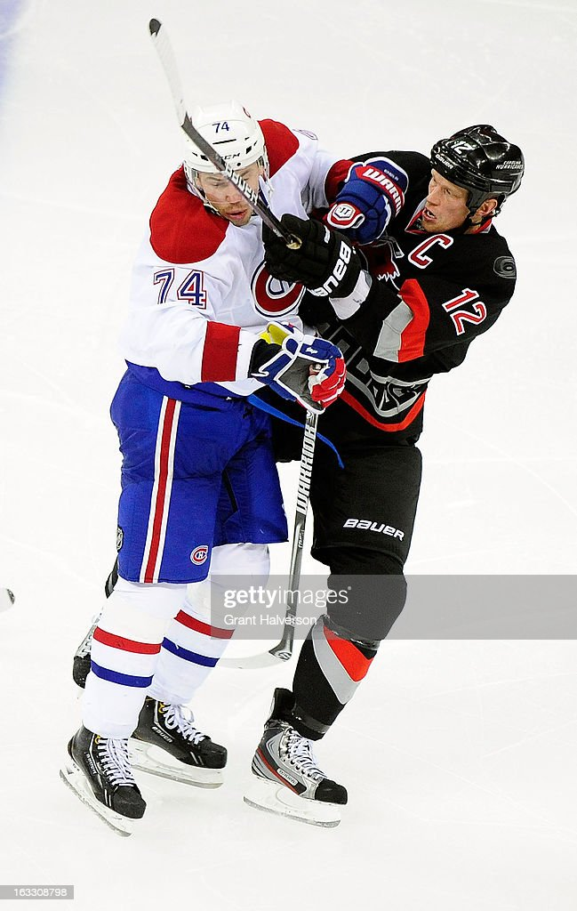 <a gi-track='captionPersonalityLinkClicked' href=/galleries/search?phrase=Alexei+Emelin&family=editorial&specificpeople=723573 ng-click='$event.stopPropagation()'>Alexei Emelin</a> #74 of the Montreal Canadiens hits <a gi-track='captionPersonalityLinkClicked' href=/galleries/search?phrase=Eric+Staal&family=editorial&specificpeople=202199 ng-click='$event.stopPropagation()'>Eric Staal</a> #12 of the Carolina Hurricanes during play at PNC Arena on March 7, 2013 in Raleigh, North Carolina. The Canadiens won 4-2.