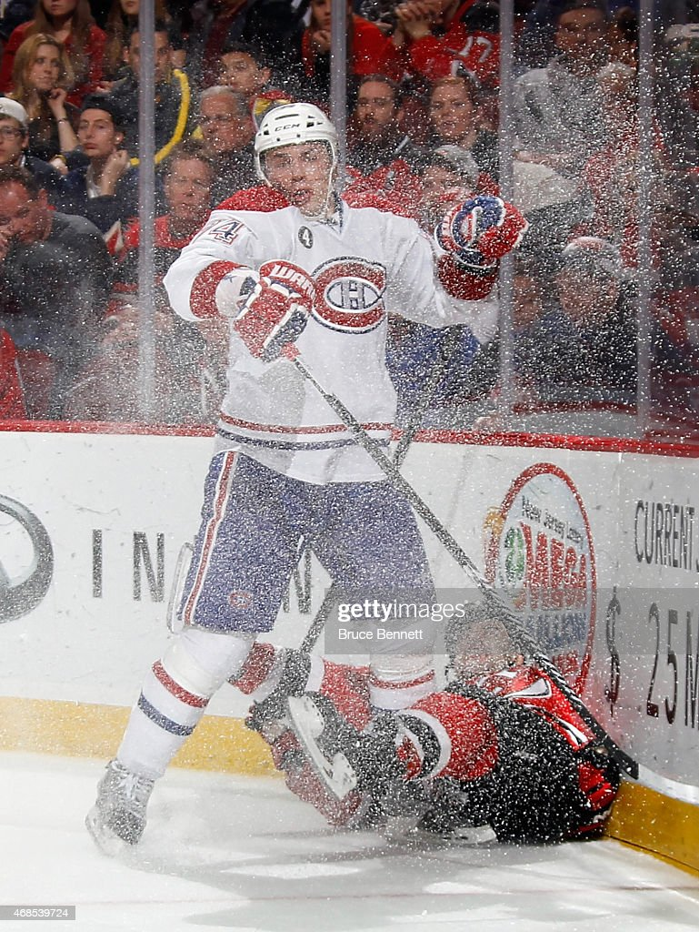 <a gi-track='captionPersonalityLinkClicked' href=/galleries/search?phrase=Alexei+Emelin&family=editorial&specificpeople=723573 ng-click='$event.stopPropagation()'>Alexei Emelin</a> #74 of the Montreal Canadiens hits <a gi-track='captionPersonalityLinkClicked' href=/galleries/search?phrase=Scott+Gomez&family=editorial&specificpeople=201782 ng-click='$event.stopPropagation()'>Scott Gomez</a> #21 of the New Jersey Devils into the boards during the second period at the Prudential Center on April 3, 2015 in Newark, New Jersey.