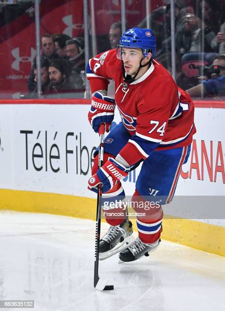 Alexei Emelin of the Montreal Canadiens looks to pass the puck against the Dallas Stars in the NHL game at the Bell Centre on March 28 2017 in...