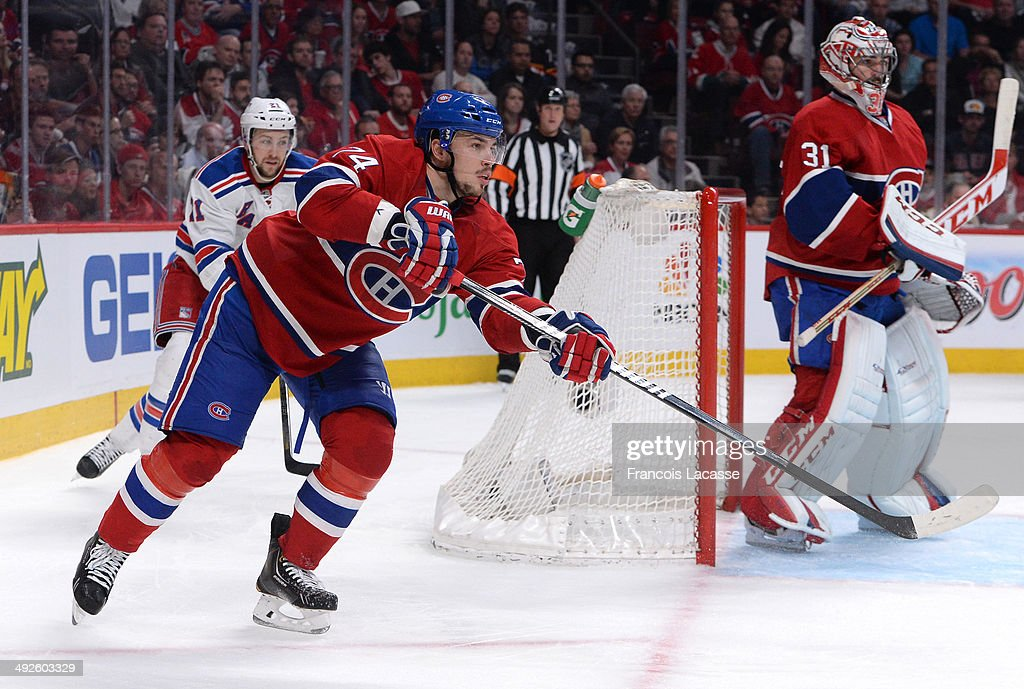 Alexei Emelin #74 of the Montreal Canadiens makes a pass nex to Carey Price #31, followed by Derek Stepan #21 of the New York Rangers in Game One of the Eastern Conference Final during the 2014 Stanley Cup Playoffs at the Bell Centre on May 17, 2014 in Montreal, Quebec, Canada.