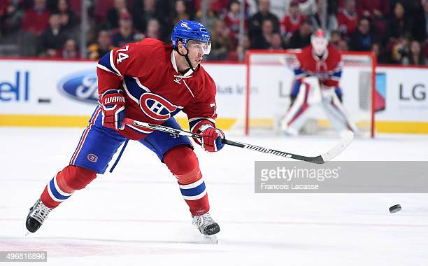 Alexei Emelin of the Montreal Canadiens passes the puck against the Boston Bruins in the NHL game at the Bell Centre on November 7 2015 in Montreal...