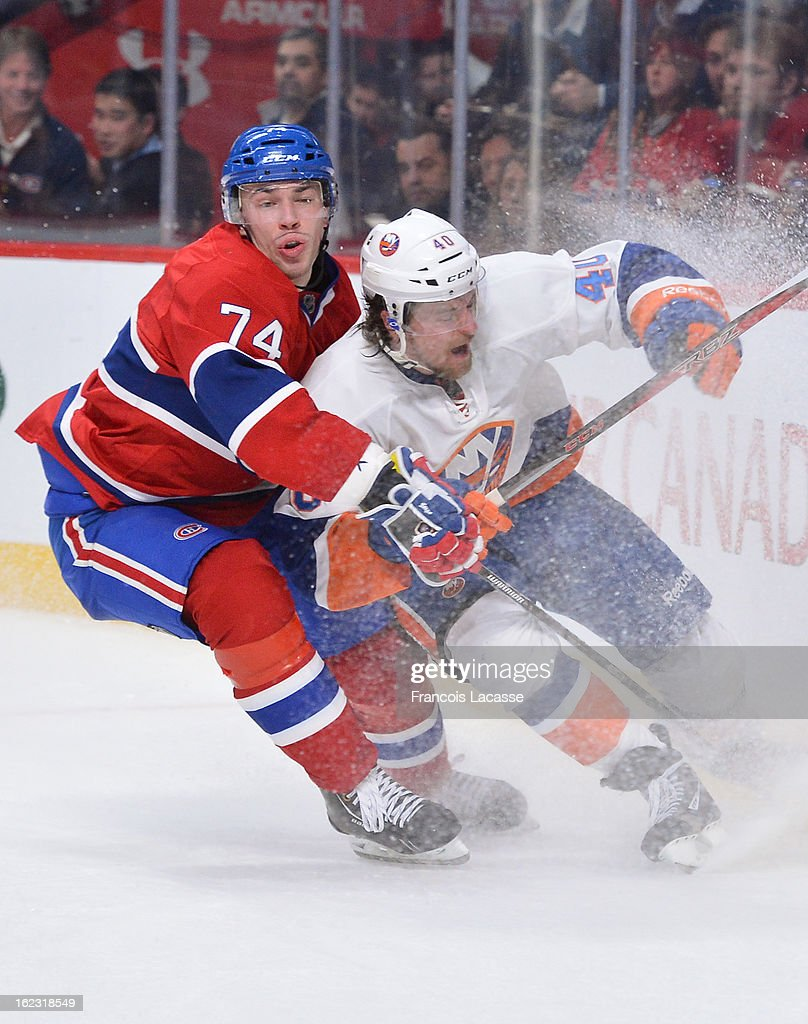 Alexei Emelin #74 of the Montreal Canadiens puts pressure on Michael Grabner #40 of the New York Islanders during the NHL game on February 21, 2013 at the Bell Centre in Montreal, Quebec, Canada.