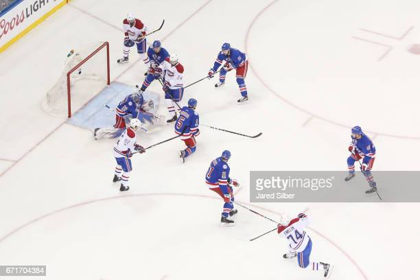 Alexei Emelin of the Montreal Canadiens shoots and scores in the first period against Henrik Lundqvist of the New York Rangers in Game Six of the...
