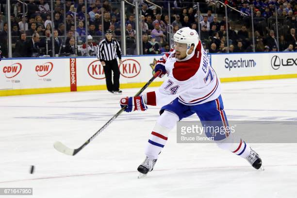 Alexei Emelin of the Montreal Canadiens shoots the puck to score a goal against Henrik Lundqvist of the New York Rangers during the first period in...