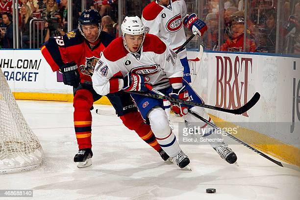 Alexei Emelin of the Montreal Canadiens skates with the puck against Jaromir Jagr of the Florida Panthers at the BBT Center on April 5 2015 in...