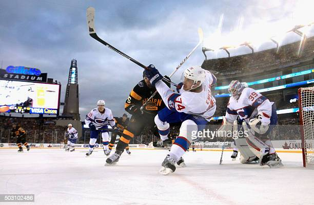 Alexei Emelin of the Montreal Canadiens takes a shot in front of goaltender Mike Condon during the 2016 Bridgestone NHL Classic at Gillette Stadium...
