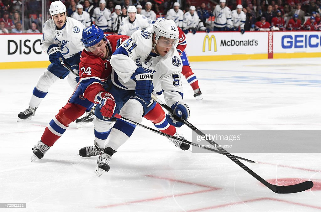 <a gi-track='captionPersonalityLinkClicked' href=/galleries/search?phrase=Alexei+Emelin&family=editorial&specificpeople=723573 ng-click='$event.stopPropagation()'>Alexei Emelin</a> #74 of the Montreal Canadiens tries to reach the puck against <a gi-track='captionPersonalityLinkClicked' href=/galleries/search?phrase=Valtteri+Filppula&family=editorial&specificpeople=2234404 ng-click='$event.stopPropagation()'>Valtteri Filppula</a> #51 of the Tampa Bay Lightning in Game 2 of the Eastern Conference Semifinals during the NHL Stanley Cup Playoffs at the Bell Centre on May 03, 2015 in Montreal, Quebec, Canada.