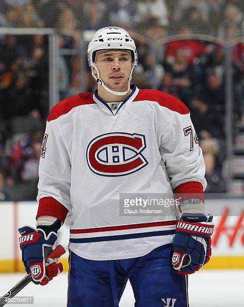 Alexei Emelin of the Montreal Canadiens waits for a puck drop against the Toronto Maple Leafs during an NHL game at the Air Canada Centre on March 22...