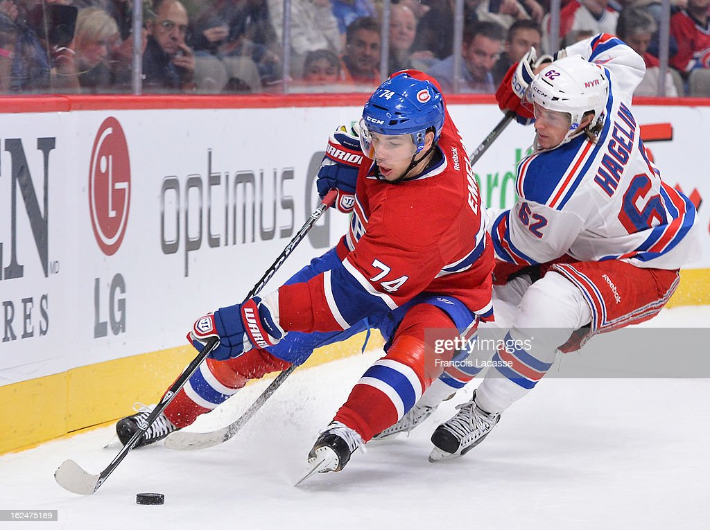 <a gi-track='captionPersonalityLinkClicked' href=/galleries/search?phrase=Alexei+Emelin&family=editorial&specificpeople=723573 ng-click='$event.stopPropagation()'>Alexei Emelin</a> #74 of the Montreal Canadienskeeps the puck away from <a gi-track='captionPersonalityLinkClicked' href=/galleries/search?phrase=Carl+Hagelin&family=editorial&specificpeople=4465394 ng-click='$event.stopPropagation()'>Carl Hagelin</a> #62 of the New York Rangers during the NHL game on February 23, 2013 at the Bell Centre in Montreal, Quebec, Canada.