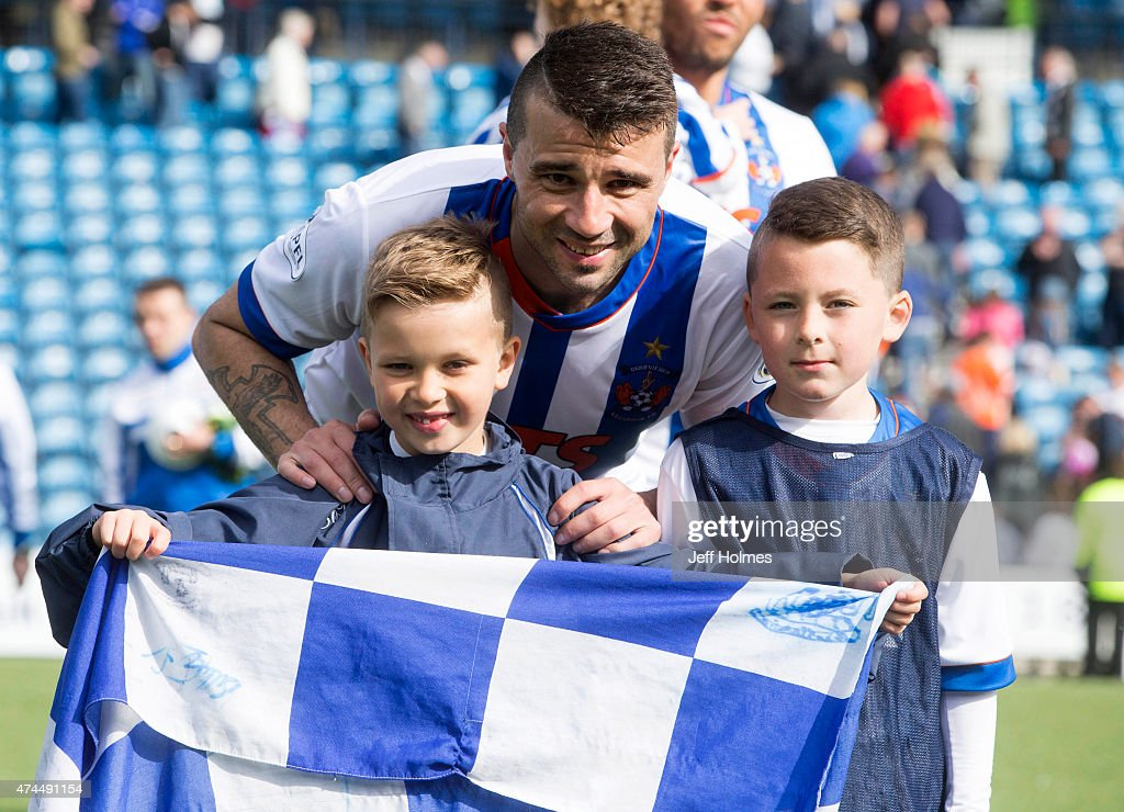 Alexei Eremenko of Kilmarnock poses with his children after the Scottish premiership match between Kilmarnock and Ross County at Rugby Park on May 23, 2015 in Kilmarnock, Scotland.