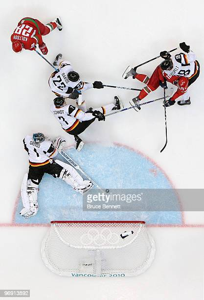 Alexei Kaliuzhny of Belarus scores a second period goal against goalie Thomas Greiss of Germany during the ice hockey men's preliminary game on day 9...