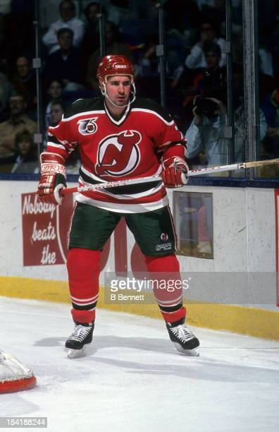 Alexei Kasatonov of the New Jersey Devils skates behind the net during an NHL game against the New York Islanders on December 14 1991 at the Nassau...