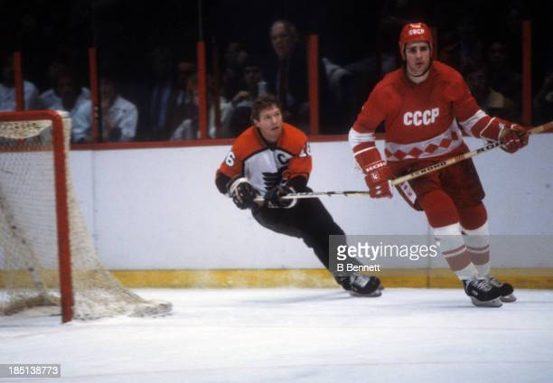 Alexei Kasatonov of the USSR skates on the ice as Bobby Clarke of the Philadelphia Flyers follows behind during the 198283 Super Series on January 6...