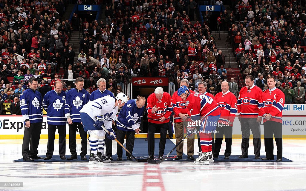 Alexei Kovalev #27 of the Montreal Canadiens and Tomas Kaberle #15 the Toronto Maple Leafs take a ceremonial faceoff with Johnny Bower, Jean Beliveau and other former greats as the teams salute their Original Six rivalry at the Bell Centre on January 8, 2009 in Montreal, Quebec, Canada.