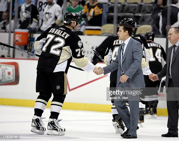 Alexei Kovalev of the Pittsburgh Penguins shakes hands with Tampa Bay Lightning coach Guy Boucher after Game Seven of the Eastern Conference...