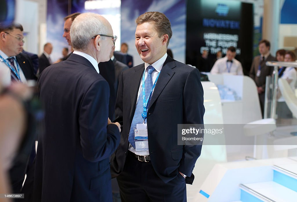 <a gi-track='captionPersonalityLinkClicked' href=/galleries/search?phrase=Alexei+Miller&family=editorial&specificpeople=713081 ng-click='$event.stopPropagation()'>Alexei Miller</a>, chief executive officer of OAO Gazprom, right, greets a fellow delegate, left, on day one of the Saint Petersburg International Economic Forum 2012 (SPIEF) in Saint Petersburg, Russia, on Thursday, June 21, 2012. Russia's showcase investment conference, a three-day event, features foreign executives including Citigroup Inc.'s Vikram Pandit and Goldman Sachs Group Inc.'s Lloyd Blankfein. Photographer: Simon Dawson/Bloomberg via Getty Images