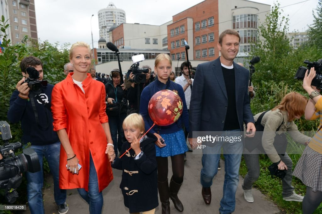 Alexei Navalny (R), a top critic of President Vladimir Putin, goes to a polling station during a mayoral election in Moscow, on September 8, 2013, with Navalny's family, daughter Dasha (2nd R), son Zakhar (2nd L) and wife, Yulia (L), accompanying him. Navalny faced today a Kremlin-backed incumbent in a hotly contested Moscow mayoral poll, the first time an opposition leader has been allowed to stand in a high-profile election.