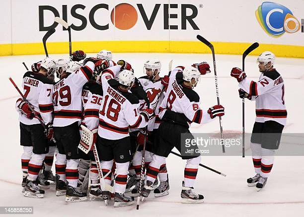 Alexei Ponikarovsky Dainius Zubrus of the New Jersey Devils and teammates celebrate their 31 win over the Los Angeles Kings in Game Four of the 2012...