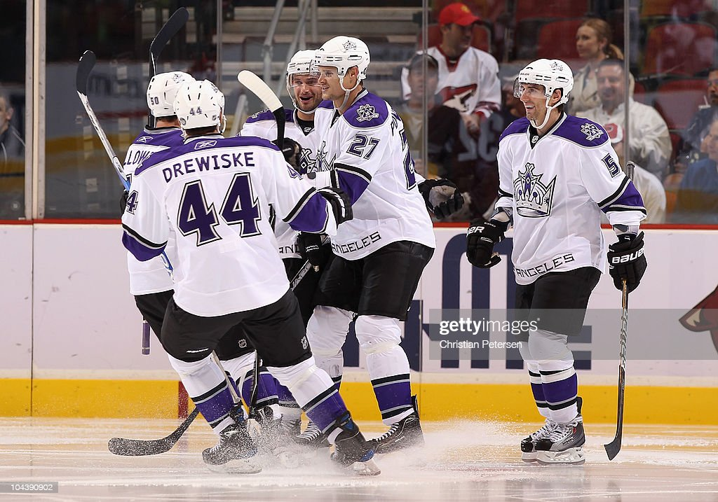 Alexei Ponikarovsky of the Los Angeles Kings celebrates with teammates after scoring a second period goal against the Phoenix Coyotes during the...