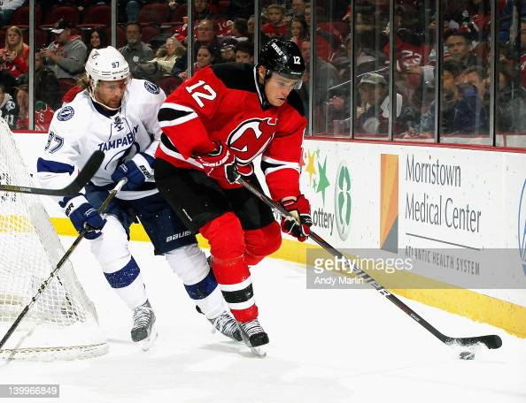 Alexei Ponikarovsky of the New Jersey Devils controls the puck while being defended by Matt Gilroy of the Tampa Bay Lightning during the game at the...
