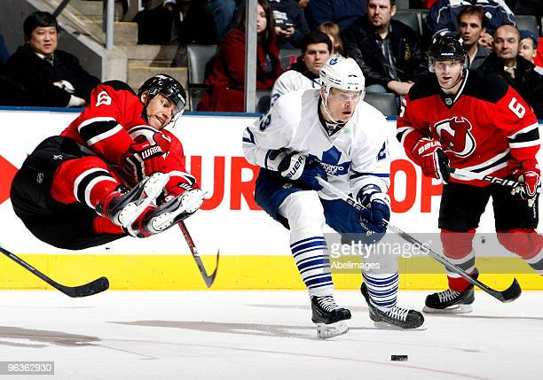 Alexei Ponikarovsky of the Toronto Maple Leafs trips up Dainius Zubrus of the New Jersey Devils during game action February 2 2010 at the Air Canada...
