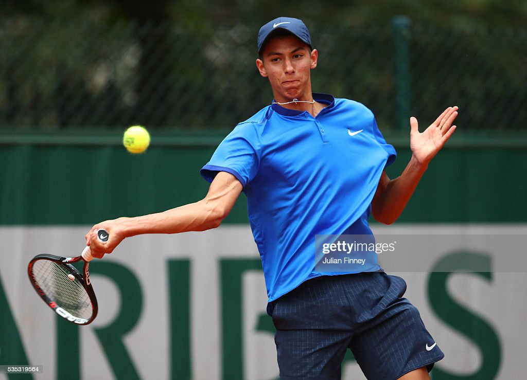 Alexei Popryn of Australia hits a forehand during the Boys Singles first round match against Dan Added of France on day eight of the 2016 French Open at Roland Garros on May 29, 2016 in Paris, France.