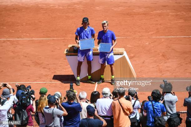 Alexei Popyrin of Australia and Nicola Kuhn of Spain during the day 14 of the French Open at Roland Garros on June 10 2017 in Paris France