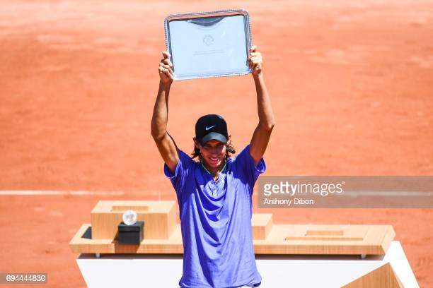 Alexei Popyrin of Australia celebrates his victory with the trophy during the day 14 of the French Open at Roland Garros on June 10 2017 in Paris...