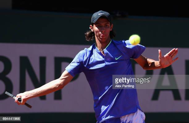 Alexei Popyrin of Australia plays a forehand during the boys singles final match against Nicola Kuhn of Spain on day fourteen of the 2017 French Open...