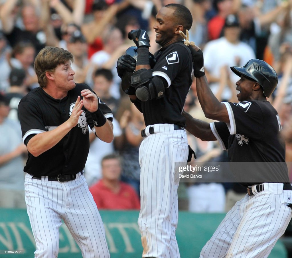 Alexei Ramierez #10 of the Chicago White Sox, Gordon Beckham #15 (L) and Juan Pierre #1 celebrate the Sox victory against the Minnesota Twins on July 9, 2011 at U.S. Cellular Field in Chicago, Illinois. The White Sox defeated the Twins 4-3.