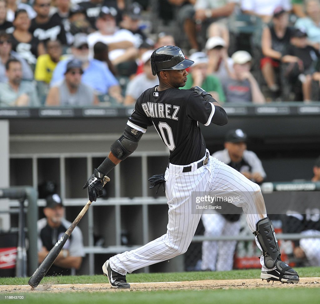 Alexei Ramierez #10 of the Chicago White Sox hits a single in the ninth inning driving in the winning run against the Minnesota Twins on July 9, 2011 at U.S. Cellular Field in Chicago, Illinois. The White Sox defeated the Twins 4-3.