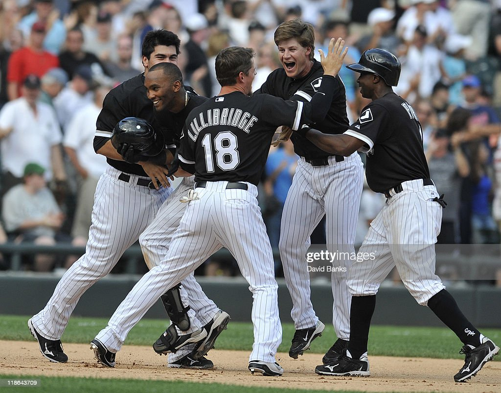 Alexei Ramierez #10 of the Chicago White Sox is greeted by his teammates after hitting the game winning single against the Minnesota Twins on July 9, 2011 at U.S. Cellular Field in Chicago, Illinois. The White Sox defeated the Twins 4-3.