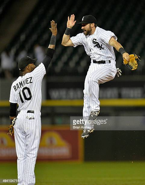 Alexei Ramirez and Adam Eaton of the Chicago White Sox celebrate their 21 win over the Cleveland Indians at US Cellular Field on May 28 2014 in...
