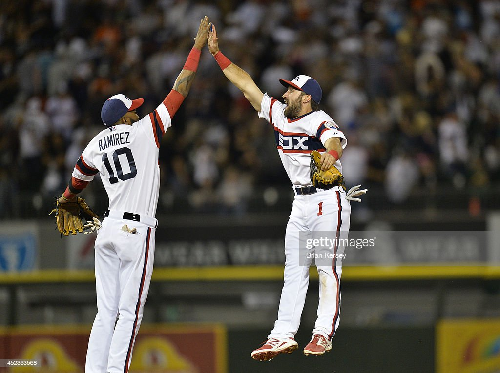 Alexei Ramirez #10 and Adam Eaton #1 of the Chicago White Sox celebrate their win over the Houston Astros at U.S. Cellular Field on July 18, 2014 in Chicago, Illinois. The White Sox defeated the Astros 3-2.