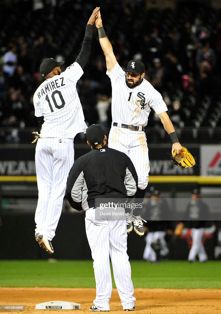 Alexei Ramirez #10 of the Chicago White Sox and Adam Eaton #1 celebrate their win against the Detroit Tigers on October 2, 2015 at U.S. Cellular Field in Chicago, Illinois. The White Sox won 2-1.