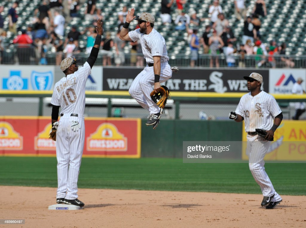 <a gi-track='captionPersonalityLinkClicked' href=/galleries/search?phrase=Alexei+Ramirez&family=editorial&specificpeople=690568 ng-click='$event.stopPropagation()'>Alexei Ramirez</a> #10 of the Chicago White Sox and <a gi-track='captionPersonalityLinkClicked' href=/galleries/search?phrase=Adam+Eaton&family=editorial&specificpeople=210898 ng-click='$event.stopPropagation()'>Adam Eaton</a> #1 high-five after their win on May 26, 2014 at U.S. Cellular Field in Chicago, Illinois. The Chicago White Sox defeated the Cleveland Indians 6-2.