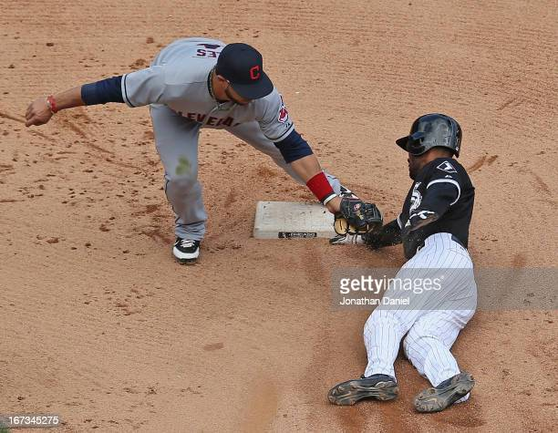 Alexei Ramirez of the Chicago White Sox beats the tag at second base by Mike Aviles of the Cleveland Indians for a steal at US Cellular Field on...