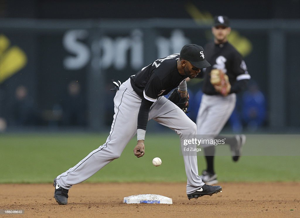 <a gi-track='captionPersonalityLinkClicked' href=/galleries/search?phrase=Alexei+Ramirez&family=editorial&specificpeople=690568 ng-click='$event.stopPropagation()'>Alexei Ramirez</a> #10 of the Chicago White Sox can't control a ball hit by Eric Hosmer of the Kansas City Royals in the fifth inning at Kauffman Stadium on May 4, 2013 in Kansas City, Missouri. Hosmer picked up a single on the play.