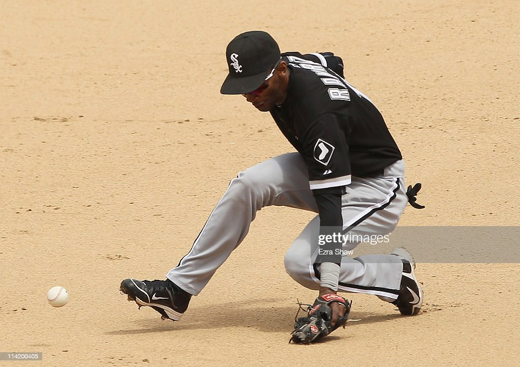 <a gi-track='captionPersonalityLinkClicked' href=/galleries/search?phrase=Alexei+Ramirez&family=editorial&specificpeople=690568 ng-click='$event.stopPropagation()'>Alexei Ramirez</a> #10 of the Chicago White Sox can't stop a ball hit by Cliff Pennington #2 of the Oakland Athletics in the seventh inning at Oakland-Alameda County Coliseum on May 15, 2011 in Oakland, California.