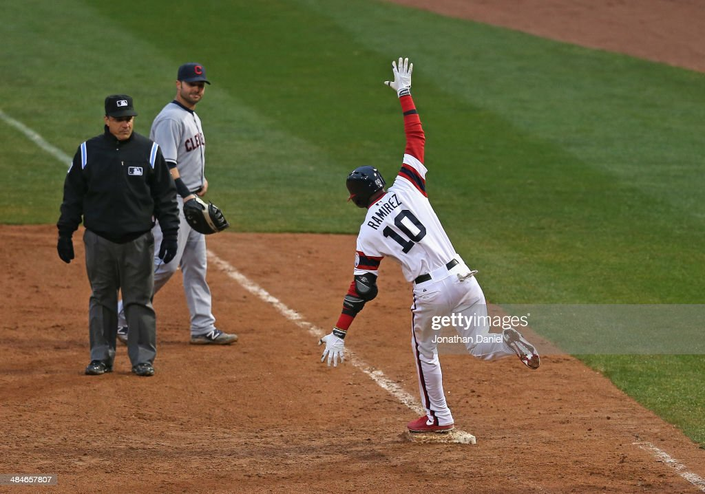 <a gi-track='captionPersonalityLinkClicked' href=/galleries/search?phrase=Alexei+Ramirez&family=editorial&specificpeople=690568 ng-click='$event.stopPropagation()'>Alexei Ramirez</a> #10 of the Chicago White Sox celebrates hitting a two-run, walk-off home run in the bottom of the 9th inning as <a gi-track='captionPersonalityLinkClicked' href=/galleries/search?phrase=Nick+Swisher&family=editorial&specificpeople=206417 ng-click='$event.stopPropagation()'>Nick Swisher</a> #33 of the Cleveland Indians and umpire <a gi-track='captionPersonalityLinkClicked' href=/galleries/search?phrase=Phil+Cuzzi&family=editorial&specificpeople=260231 ng-click='$event.stopPropagation()'>Phil Cuzzi</a> #10 watch at U.S. Cellular Field on April 13, 2014 in Chicago, Illinois. The White Sox defeated the Indians 4-3.