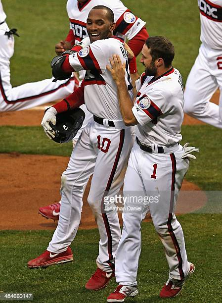 Alexei Ramirez of the Chicago White Sox celebrates with Adam Eaton after hitting a tworun walkoff home run in the bottom of the 9th inning to defeat...